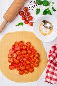 Cherry tomato tart. Cooking process.