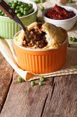 Tasty Australian Meat Pie In A Pot On The Table. Vertical