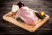 picture of turkey-hen  - Raw turkey fillet on cutting board  - JPG