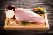 stock photo of turkey-hen  - Raw turkey fillet on cutting board  - JPG
