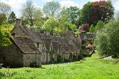 Bibury. Arlington Row: Cotswold stone cottages  in beautiful spring day. England, UK.