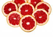Scattered On Top Grapefruit Slices, Can Be Used As A Background, Isolated On A White