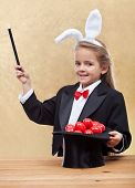 Behold the red easter eggs - little magician bunny girl with magic hat-shallow depth of field