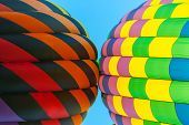 Two Hot Air Balloons Touch One Another