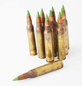 stock photo of cartridge  - Loaded cartridges that have bullets with green tips - JPG