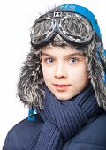 Cheerful kid wearing winter clothes on white background