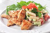 Chicken and pasta salad with tomato and cucumber