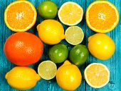 Assortment of citrus fruits on wooden surface