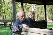 Older People Sitting In The Arbor