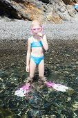 little girl on the beach at sea ready for snorkeling