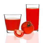 Tomato Juice In A Glass And Red Tomatoes On A White Background
