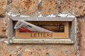 Old Letter Slot With Newspaper Closeup.