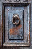 Dark Wooden Door Panel With Door Knocker.