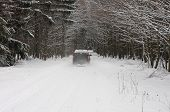 Car On Road In Forest In Winter