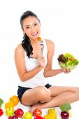Asian Chinese woman eating healthy salad