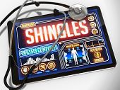 picture of shingles  - Medical Tablet with the Diagnosis of Shingles on the Display and a Black Stethoscope on White Background - JPG
