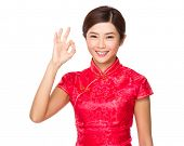 Chinese woman with ok sign