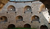 Old medieval wall with loopholes