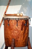 foto of timpani  - Medieval drum of wood and leather and pair of mallets - JPG