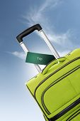 Trip. Green Suitcase With Label