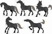 Five silhouette frolicking horses isolated on white