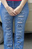 Woman In Blue Grunge Jeans Standing Near Auto