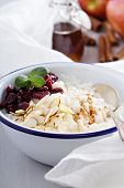 Breakfast rice porridge with almonds and cranberry