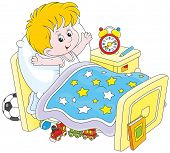 pic of stretch  - Little boy waking up and stretching in his bed at home - JPG
