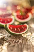 picture of jello  - Strawberry jello served in lime shells on wooden table  - JPG
