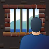 stock photo of jail  - An arrested man is looking out of the barred window of a jail - JPG