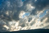 foto of paysage  - Clouds at sunset over the dark mountain - JPG