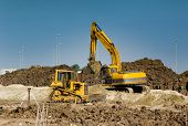 picture of excavator  - Excavator and bulldozer working at big construction site - JPG