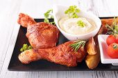 foto of fried chicken  - fried chicken leg with french fries and sauce - JPG