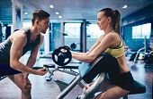 foto of arm muscle  - Young woman strengthening arm muscles in gym - JPG