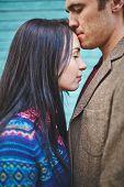 stock photo of amor  - Amorous man kissing his girlfriend on forehead - JPG