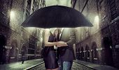 stock photo of rainy season  - Elegant couple on rainy evening - JPG