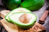 picture of avocado  - fresh ripe avocado on a wooden cutting board - JPG