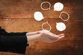 picture of presenting  - Businesswomans hands presenting against overhead of wooden planks - JPG