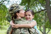picture of reunited  - Soldier reunited with her daughter on a sunny day - JPG
