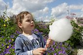 foto of candy cotton  - Kid with cotton candy in the park - JPG