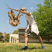 image of pit-bull  - American pit bull terrier jumping high at a park - JPG