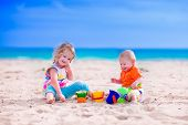 picture of girl toy  - Kids play on a beach - JPG