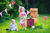 picture of little young child children girl toddler  - Kids playing with a toy kitchen - JPG