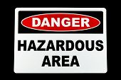 foto of hazardous  - A hazardous area danger sign against a black background - JPG