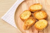picture of home-made bread  - Home made garlic bread on wooden plate - JPG