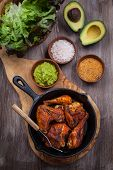 picture of chickens  - Grilled chicken legs and wings with guacamole - JPG