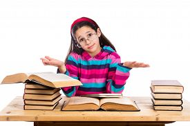image of ignore  - Confused girl with pile of old books showing ignorance - JPG