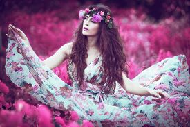 pic of flutter  - beautiful playful fairy  woman in fluttering floral dress in unreal pink field  - JPG