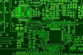 Close-up image of green board made for surface mount technology with one many-pins semiconductor com
