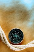 Compass with rope on acient abstract paper